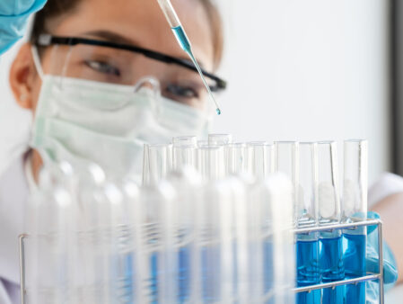 Medical,Scientists,Released,A,Sample,Pipette,Into,A,Test,Tube